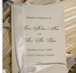 Ivory programs with simple black script, tied with ivory ribbon, fit in with the traditional ceremony decor.