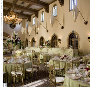 Apple green linens, shell pink napkins, gold-beaded chargers and elaborate floral centerpieces created a lush garden feel inside the reception space.