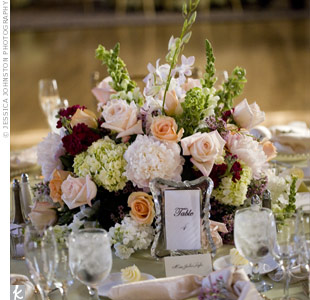A mixture of high and low centerpieces filled with peonies, amaryllis, roses, hydrangeas and dendrobium orchids became a focal point for each table. Sprigs of fragrant raspberry and lavender freshened up the room.