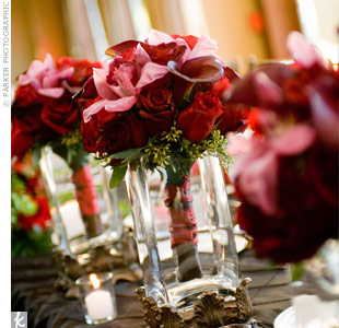 The bridesmaids carried deep red calla lilies, black magic roses and cymbidium orchids tied with red ribbon.