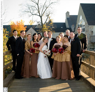 Gold wraps stood out against the bridesmaid's two-piece, floor -- length, chocolate brown dresses. 