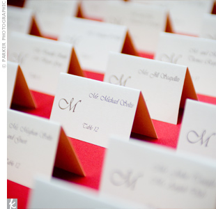 Simple and classic, the cream, tented escort cards were printed with the couple&#39;s monogram.