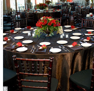To complete the rich fall look, lush bright red centerpieces sat on pin-tucked chocolate brown linens.