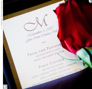 Taupe menu cards trimmed in brown and stamped with the couple&#39;s monogram popped against the chocolate brown napkins.