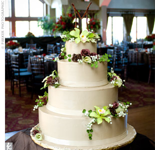 Smooth icing provided the perfect canvas for the sugar cymbidium orchids, roses, mini calla lilies and green berries.