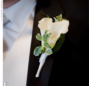 The groom's white calla lily matched the bride's bouquet.