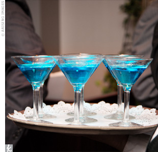 "Aqua blue ""sleightinis"" made with vodka, blue Curacao and a twisted lemon peel set the tone for the winter-themed wedding reception."