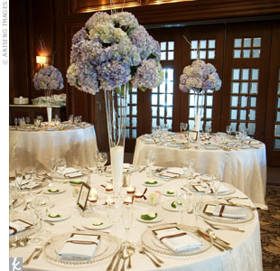 White linens and china stood out against the mahogany decor of the Detroit Club's ballroom. Lush centerpieces and ambient lighting added to the cozy, winter vibe.