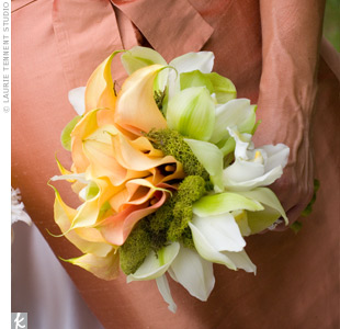 Each of the three bridesmaids carried hand-tied bouquets of mango calla lilies, while the maid of honor carried mango calla lilies and white cattleya orchids.