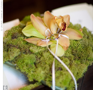 The ring bearer carried a green moss pillow topped with cymbidium orchids.