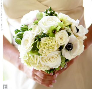C.C.&#39;s bridesmaids carried bouquets of champagne roses, hydrangeas, cream anemones, and green hypericum berries tied with cocoa brown Midori ribbon.