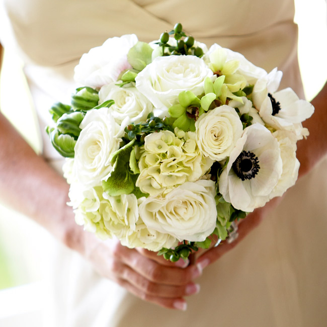 C.C.'s bridesmaids carried bouquets of champagne roses, hydrangeas, cream anemones, and green hypericum berries tied with cocoa brown Midori ribbon.