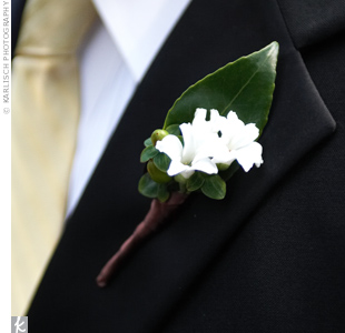 Andrew&#39;s groomsmen wore boutonnieres of cream-colored hyacinth blossoms accented with green hypericum berries.