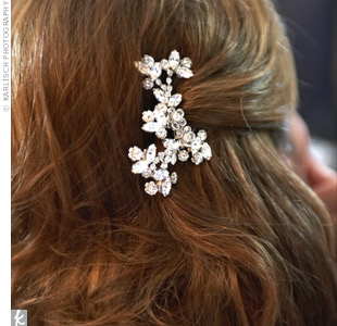 C.C. wore her hair half-up, with the portions left down curled into soft waves. She accented her style with two crystal hairpins.