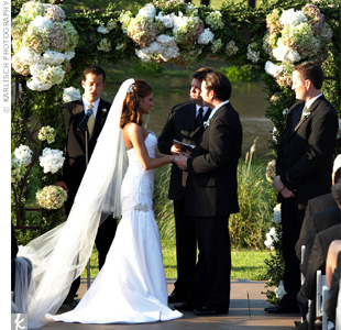 C.C. and Andrew wed outdoors in a ceremony beside a pond at the ranch. The trees in the ceremony area were strung with ribbons in the wedding colors. &quot;I still can&#39;t believe it was my dad&#39;s idea to do the ribbon -- I was so impressed he came up with that!&quot; says the bride.