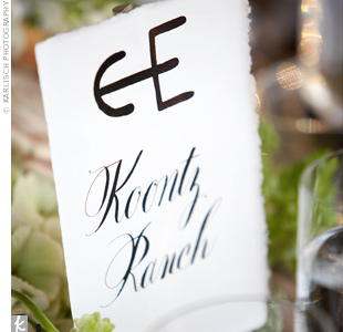 "A calligrapher created a ""wedding brand"" styled after a cattle brand of a C intertwined with an A, which the couple used on many of the wedding details. The tables were named for Texas ranches, some of which shared their names with the couple's wedding guests."