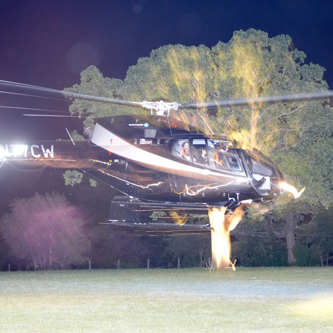 C.C. and Andrew made an especially memorable exit, taking off from their reception in a helicopter while their guests waved sparklers below.