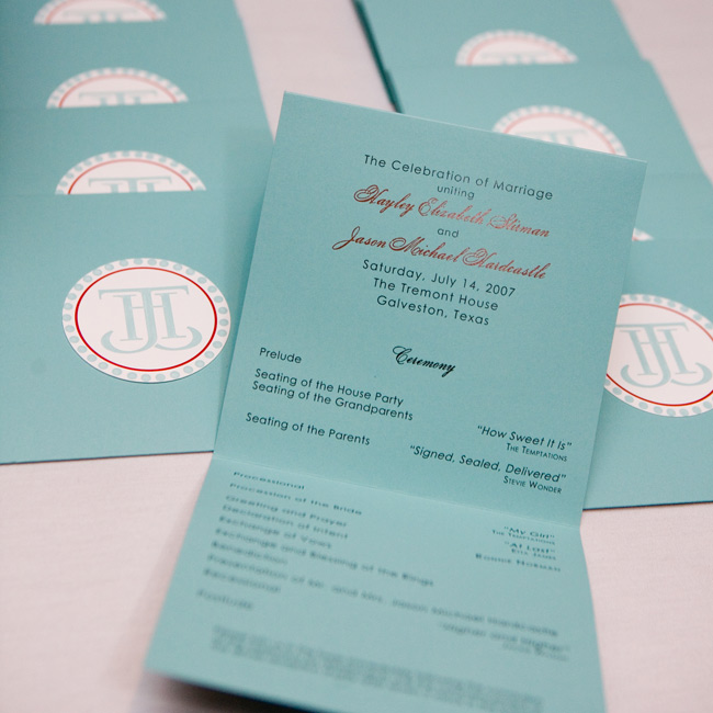 Hayley designed the ceremony programs to mimic the style of their invitations, which incorporated their monogram, the color scheme, and the square shapes used throughout the celebration.