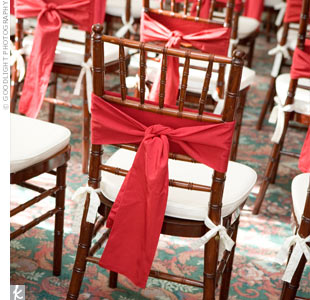 Red sashes tied to the chairs brought a dash of Hayley and Jason's color scheme into the otherwise all-white space.