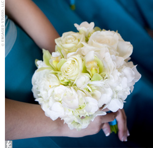The bridesmaid bouquets were created to mimic the look of the bridal bouquet, but with green accents. They included parrot lilies, green roses, tulips, and hydrangeas.