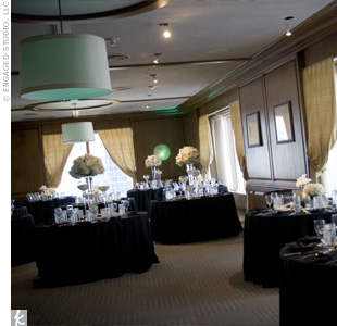 Bringing in the color of the bridesmaid dresses, The Empire Room was washed in teal light for Mai-An and Ben's reception, including a gobo light with their gardenia logo shining onto the dance floor.