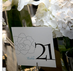 The ruffles down the back of her gown reminded Mai-An of a gardenia, so she had a custom-designed gardenia motif created for all of the stationery. It graced all of the couple's paper goods, including their table numbers.