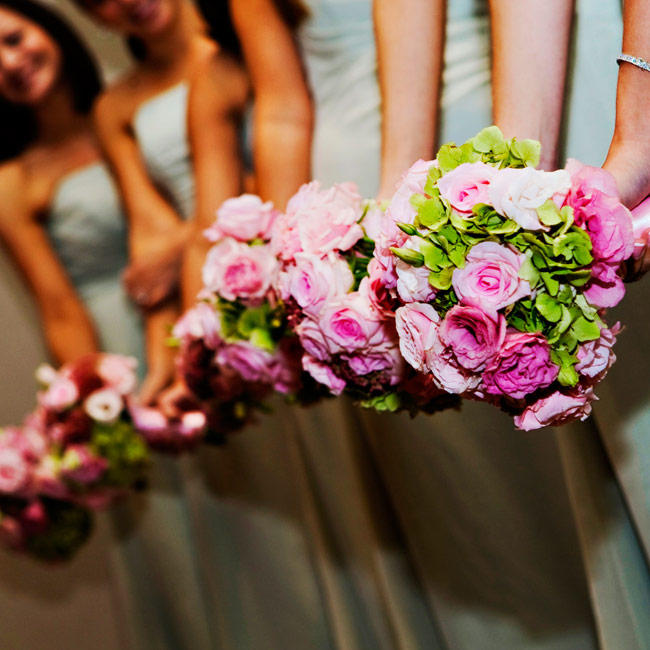Ashley's seven bridesmaids carried bouquets of lisianthuses, roses, and hydrangeas in light pink with touches of green intermixed.