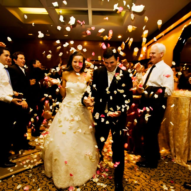 Ashley and Gavin's guests tossed rose petals in ivory and shades of pink into the air as the couple made their grand exit from the reception.