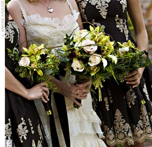 Kristle carried a loosely structured bouquet of maidenhair fern, green cymbidium orchids, miniature white calla lilies, champagne roses, fringed cream tulips, green hydrangeas, chocolate cosmos, green amaranthus, bear grass, and seeded eucalyptus with the stems wrapped in vines and moss. 