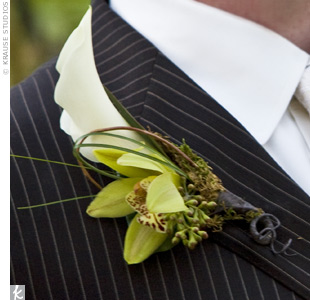 Todd wore a boutonniere of a white miniature calla lily and a green orchid blossom accented with berries and bear grass, while his two groomsmen wore green orchids.