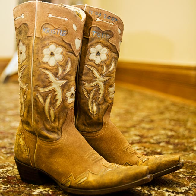 "For her ""something blue,"" Kristle had Todd's and her names and wedding date stitched in blue into a pair of Old Gringo cowboy boots."