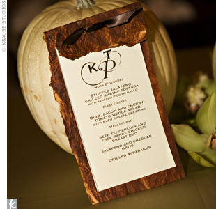 Kristle and Todd's guests found ivory hemstitched napkins and menu cards announcing the evening's feast -- which included Fort Worth delicacies like jalapeño cheddar grits and steaks branded with the couple's initials -- at each place setting.