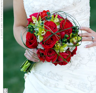 Red tulips were the first flowers Keith ever gave Leigh, which is why the bride carried a bouquet of red tulips, red roses, green hypericum, green cymbidium orchids, white hydrangea, and bear grass on her wedding day.