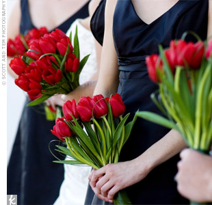 The bridal party carried red tulips and bear grass wrapped with large leaves.