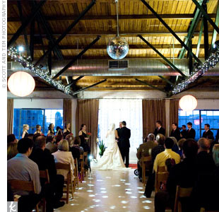 The ceremony took place at sunset in an old Gulf Oil building built in the 1900s, which looked like a New York-style loft.  The couple strung red Chinese lanterns from the rafters.