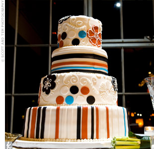 Playful polka dots, graphic flowers and stripes in black, red, and turquoise covered the four-tiered cake.