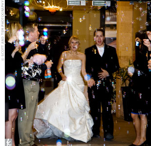 The couple made their exit down the staircase of the Hickory Street Annex while guests tossed blew bubbles.