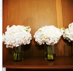 The bridesmaids carried bouquets of white roses, lilies, hydrangeas, tulips, and ranunculus.