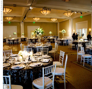 Black, silver, and white damask linens added a formal touch to the reception space. Silver chivari chairs completed the look.