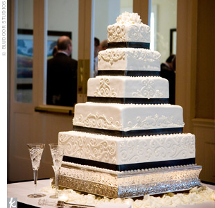 While the five-tiered cake looked stunning with its pearlized finish and elegant scrollwork, inside was even better: s'mores cake with chocolate buttercream!