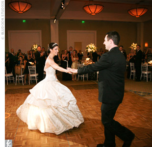 "Kelly and Rob chose ""Dancing Cheek to Cheek"" by Frank Sinatra for their first dance."