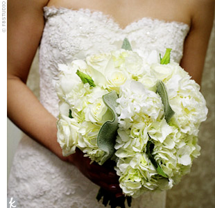The bride carried a white and ivory bouquet of hydrangeas, lisianthus, and peonies with touches of greenery.
