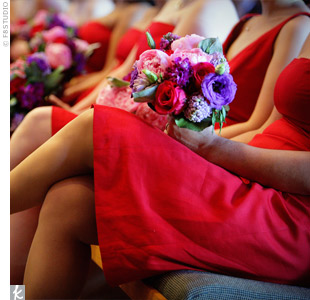 Rich blooms in red, deep purple, fuchsia, and dark blue made up the bridesmaid bouquets.
