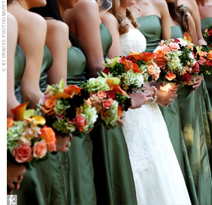 The bridesmaids carried multicolored bouquets of roses, hydrangea, coxcomb, calla lilies, and textured greenery wrapped in chocolate-brown satin ribbon.