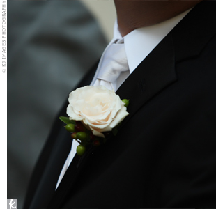 Chris wore a single white rose on his lapel.