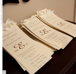 The ivory programs showcased the couple&#39;s monogram in chocolate brown.
