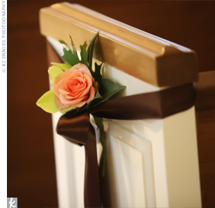 The church pews were tied off with a chocolate brown ribbon and a pale peach rose.