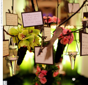 Guests were encouraged to write wishes for the couple and hang them on a tree decorated with amber-colored votives and small floral bouquets.