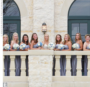 Lauren's 12 bridesmaids dressed in ice blue, full-length strapless dresses by Vera Wang. They carried bouquets of mini calla lilies, blue hydrangeas, orchids, and white roses.