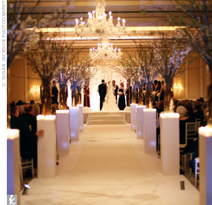 Julie and David married in a traditional Jewish ceremony held in a ballroom at The Ritz-Carlton. Their guests sat in white chiavari chairs.